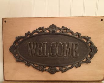 Cast Iron Welcome on Wood