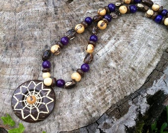Ethnic necklace with exotic seeds and coconut elements