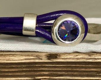 Purple Swarovski set in silver leather bracelet
