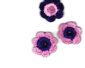 3 multicolored crocheted flowers