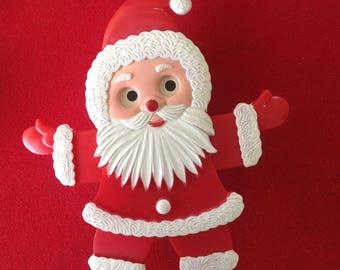 Vintage plastic musical animated jumping jack Santa Claus Christmas Holiday music box