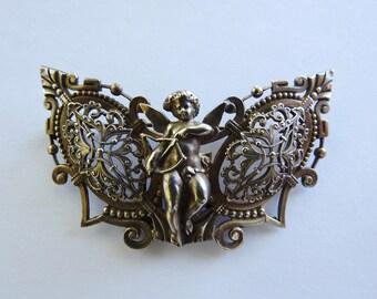 Antique Cherub Buckle Brooch
