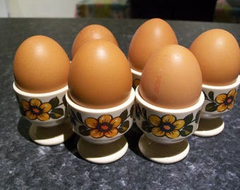 Vintage egg cups. Set of six. West Germany. Plastic. Stacking egg cups set.