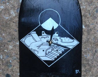 Black and White Skatepark Broken Skateboard Clock