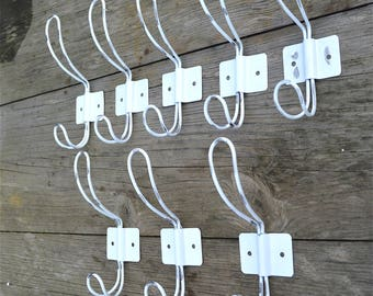A set of 8 vintage French cafe style worn white steel coathooks coat hook hanger rack