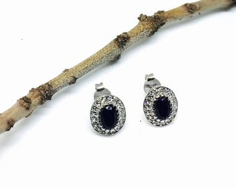 Oval black spinel and white topaz stud earrings set in sterling silver 925 . Genuine natural stones.