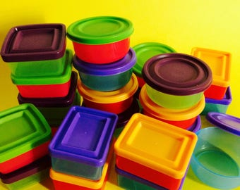 24 small multicolored plastic boxes