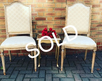 One beautiful champagne gold statement chair