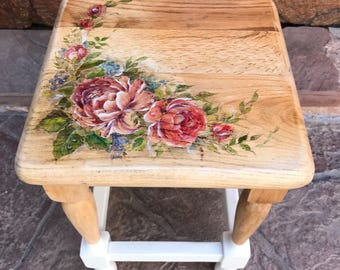 Natural wood stool painted with watercolor garden flowers.