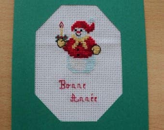 Happy new year embroidered stitch cross: a snowman in snow card