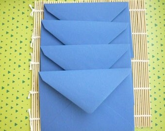 Destash at-1 euro, sold in sets of 4 blue rectangular envelopes.