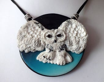A necklace with her OWL in flight