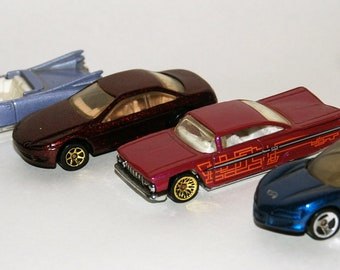 Four (count 'em, 4) '80s, '90s Hot Wheels Cars