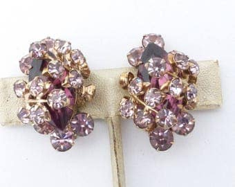 Purple and lavender rhinestone clip on earrings wire over construction AN33