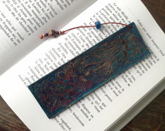 Label page engraved and painted leather, red leather lace bookmark, glass beads and metal