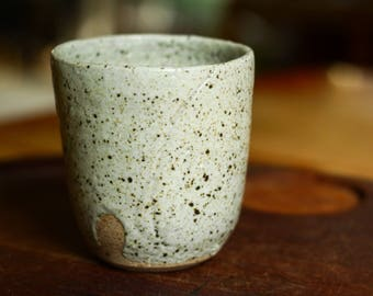 Stoneware Yunomi in oatmeal glaze with incised decoration