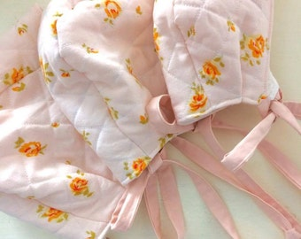 SALE  Quilted baby girl bonnet  Pink vintage floral cotton  Lined with reclaimed pale pink flannel.