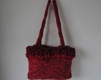 red knitted handbag, ruffle-trim purse, multi-red lined bag, knitted wool mix bag, shades of red purse, casual handbag, purse with frill top