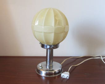 Art Deco bedside Table Lamp with a chrome-plated pedestal base and a soft beige glass globe Lampshade -- Made in the 1930s