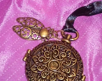 Filigree pocket watch style locket pendant