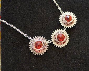 Necklace, sterling silver and ruby red swarovski crystal hand wrapped necklace