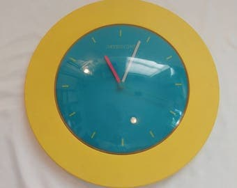 1992 Yellow and Teal Modern Time Recyco Inc. Wall Clock