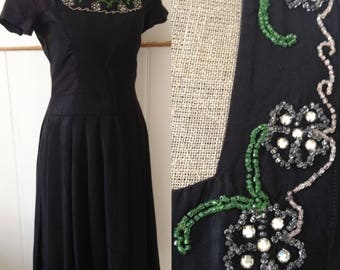 Vintage 1950s beaded dress with pleated skirt
