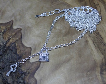Key and lock charm necklace, tibetan silver charms. Small and delicate. Hand made, Unique.