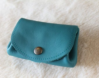 turquoise wallet; leather wallet.