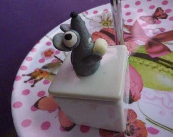 Gray box in white porcelain with mouse teeth teeth glow gruyere cheese polymer clay