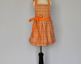 Sweet and twirly orange and pink girls apron with orange ties // Makes a great gift for your little chef - toddler apron / childrens apron