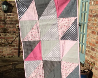 modern baby quilt, cot quilt,  play mat in pink and gray cotton fabric