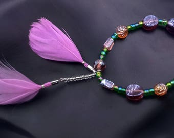 Bracelet beads and feathers