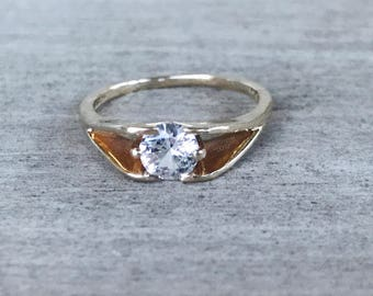 Synthetic white spinel vintage modernist ring in yellow gold