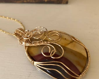 Mookaite Pendant with intricate wire wrap.   Mookaite properties are Grounding, Confidence, Decision-making