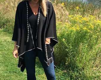 Quilted black poncho