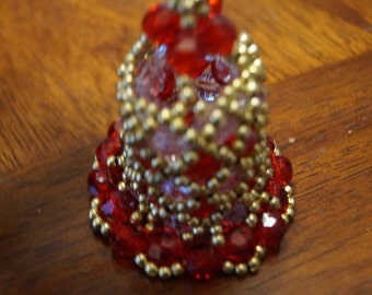 red, white and gold beaded Christmas bell