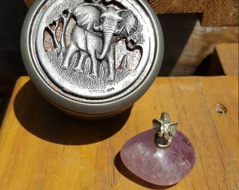 1974 Metzke metal trinket box with carved elephant. Also a pewter elephant on a purple gemstone.