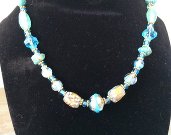 Blue Green necklace with gold tones