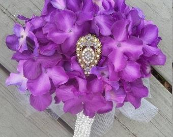 Purple hydrangea wedding bouquet with brooch center. Bridal toss wedding bouquet