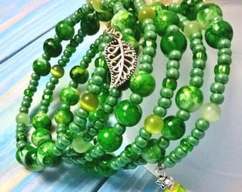 Bright green bracelet of glass beads on  memory wire