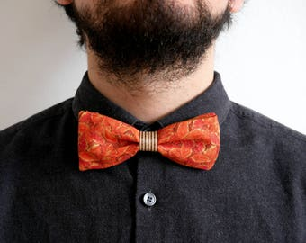 Bow tie with orange and gold floral design fabric