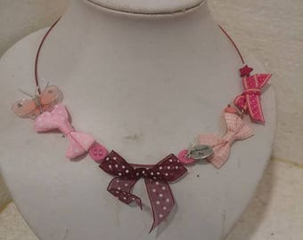 Crew neck bows, pink tones