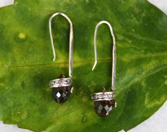 925 sterling silver earrings studded with natural smoky and zircon stones