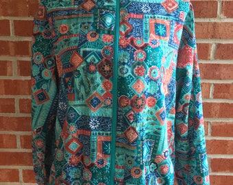 Vintage 80s Cricket Lane teal and orange pattern wind breaker jacket. Size small