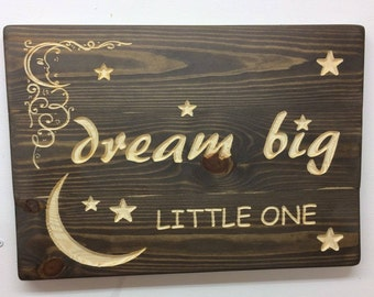 Lovely wooden Dream big little one sign in dark stain.