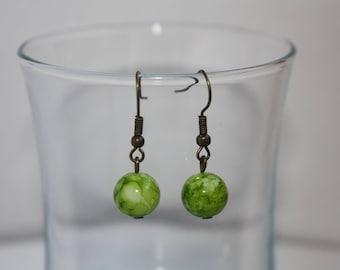 Whimsical bronze & green pearl earrings