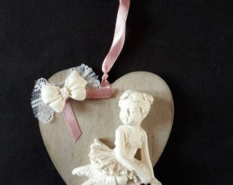 hanging heart wood and plaster dancer, various designs