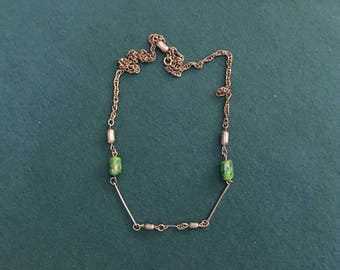 Vintage necklace with green stones on golden chain