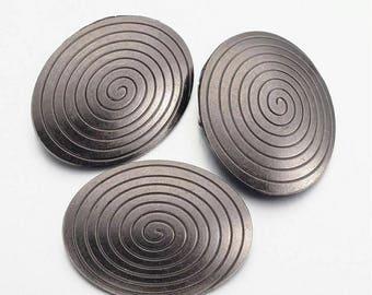 Oval Pendant, gunmetal, spiral pattern, 46 x 37 x 8 / 5 mm hole.
